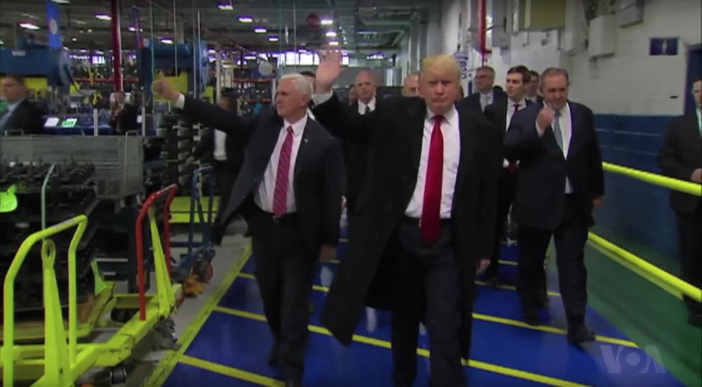 Trump walks through Carrier plant.